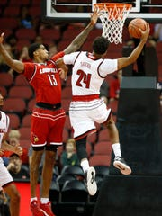 Louisville's Dwayne Sutton gets a shot off against Ray Spalding in the team's first scrimmage. Oct. 13, 2017.