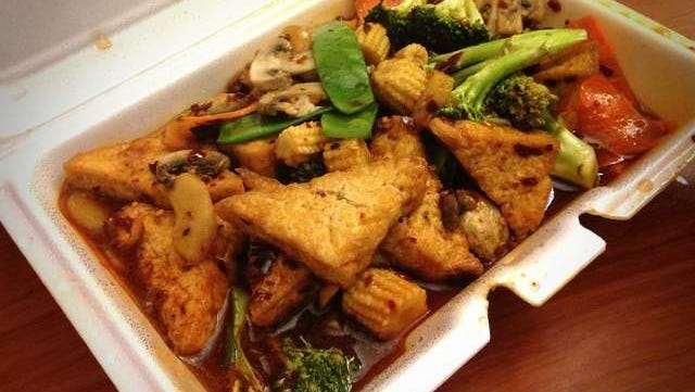 Szechwan Tofu ($8.95) is fried tofu with mixed vegetables in a spicy chili and garlic sauce.