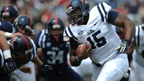 Ole Miss quarterback Jeremy Liggins scrambles for yardage during Saturday's Grove Bowl in Oxford.