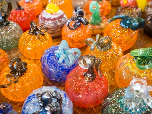 An assortment of glass pumpkins are pictured on Wednesday,