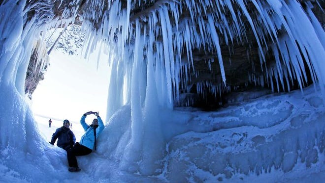 People take pictures inside a cave at Apostle Islands National Lakeshore in northern Wisconsin.