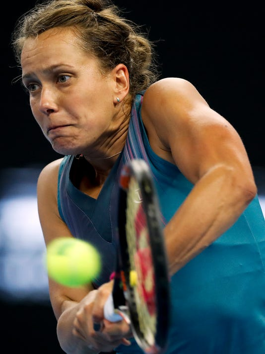 Barbara Strycova of the Czech Republic returns a shot against Garbine Muguruza of Spain during their women's singles match of the China Open tennis tournament at the Diamond Court in Beijing, Monday, Oct. 2, 2017. (AP Photo/Andy Wong)