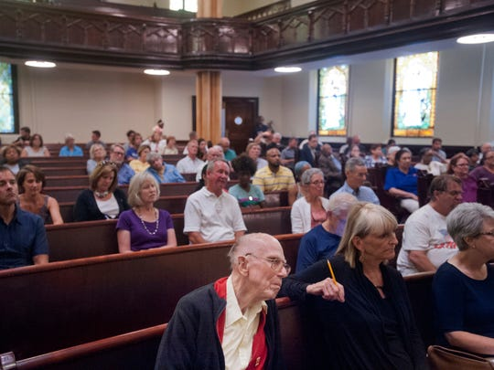 "Tom Moffett with the Kentucky Alliance Against Racist and Political Oppression is among those in the audience listening to speakers at a ""Face to Face"" community forum sponsored by Metro Louisville Council Member David James and held at the 4th Street United Methodist Church..