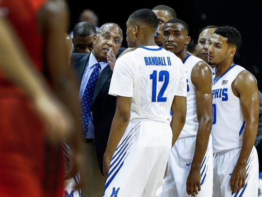 "New University of Memphis coach Tubby Smith (middle) converses wasn't demonstrative at the exhibition game against Christian Brothers University. ""Everybody loves him, everybody knows him in our business,"" said Tiger athletic director Tom Bowen."