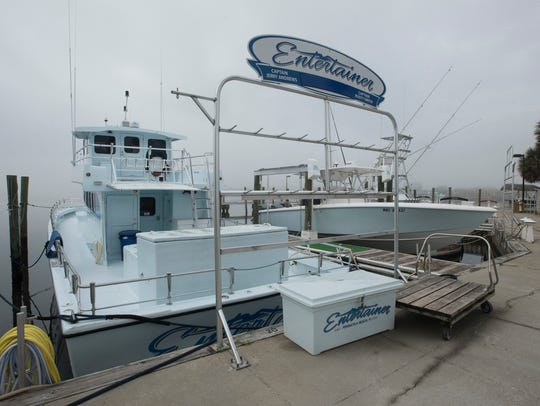 Commercial sports fishing vessels sit idle Tuesday,