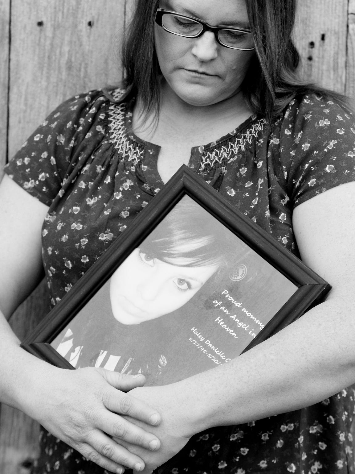 Jessica Morton holds a remembrance portrait of her