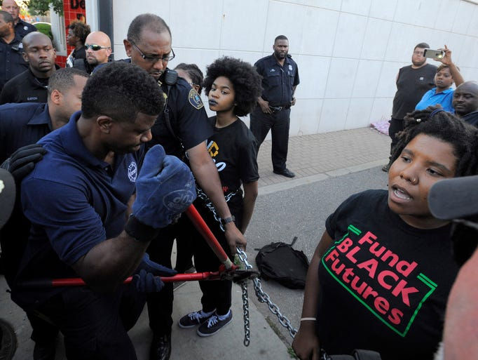 A Detroit firefighter cuts the chains of Black Lives