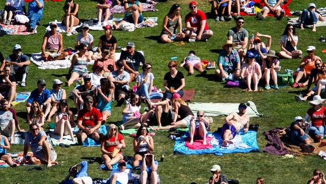 Fans watch from the lawn as the Arizona Diamondbacks face off against the Colorado Rockies during Spring Training on Sunday, March 27, 2016, at Salt River Fields at Talking Stick in Scottsdale, Ariz.