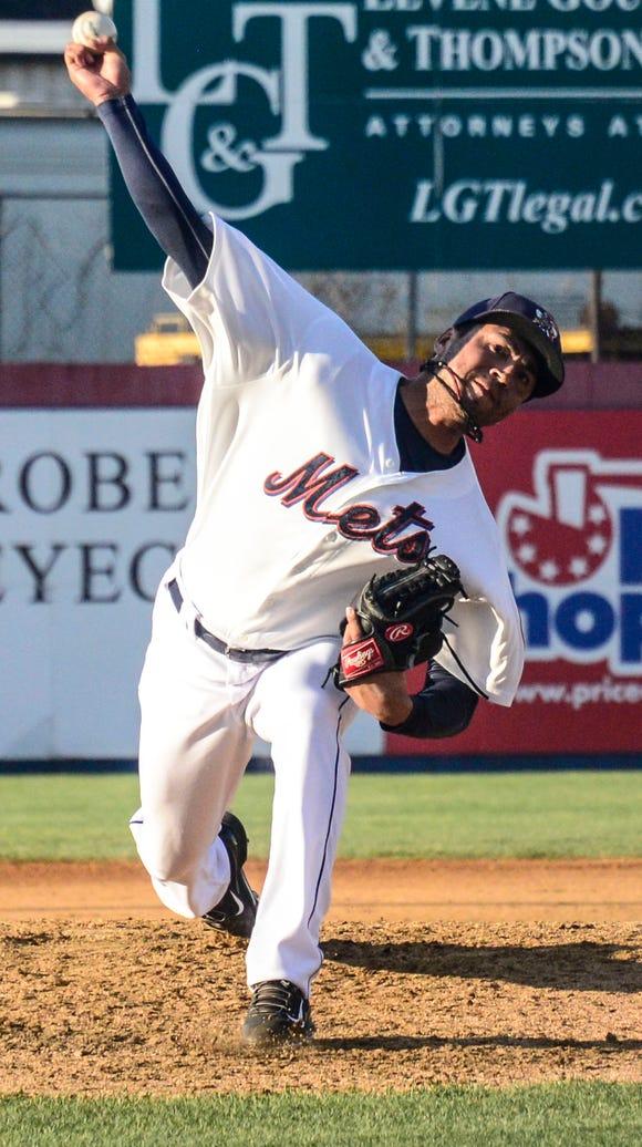 Binghamton's Jon Velasquez pitches in June.
