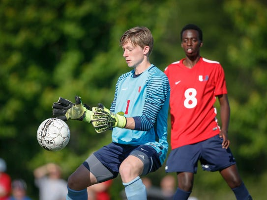 Urbandale sophomore goal keeper Eli Crow stops the