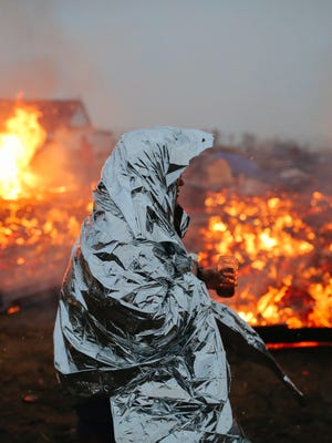 Campers set structures on fire in preparation of the Army Corp's 2 p.m. CT deadline Feb. 22, 2017, to leave the Oceti Sakowin protest camp in Cannon Ball, N.D. Activists have occupied the Standing Rock Sioux reservation for months in opposition to the completion of the Dakota Access Pipeline, and some say they'll merely move to a different site nearby.