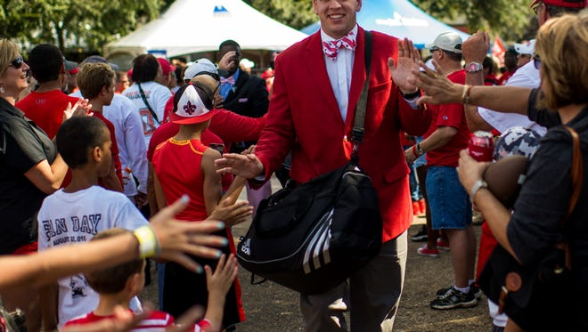UL tight end Evan Tatford is greeted by fans during the Cajun Walk prior to an NCAA football game against Northwestern State at Cajun Field Saturday, Sept. 12, 2015.