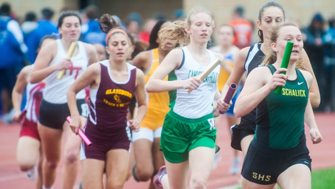 Group I runners begin the 3200m relay at the Woodbury Relays at Woodbury High School on Saturday, April 22.