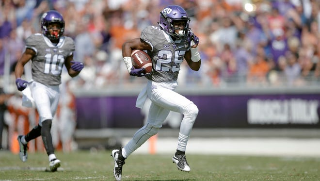 Oct 3, 2015; Fort Worth, TX, USA; Texas Christian University Horned Frogs wide receiver KaVontae Turpin (25) runs in a touchdown against the University of Texas Longhorns in the second quarter at Amon G. Carter Stadium. Mandatory Credit: Erich Schlegel-USA TODAY Sports
