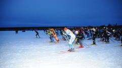 Skiers take off at the starting line for Book Across
