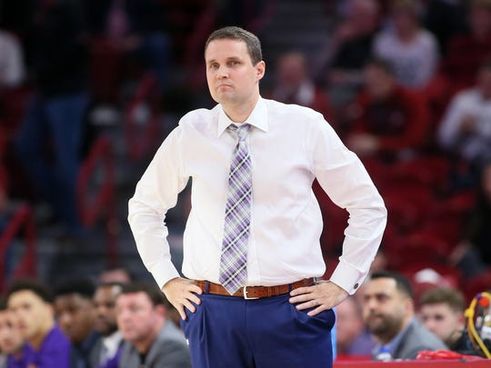Will Wade watches on the sideline during a 2020 LSU men's basketball game.