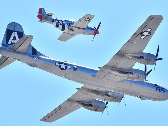 A P-51 Mustang escorts a B-29 Superfortress bomber.