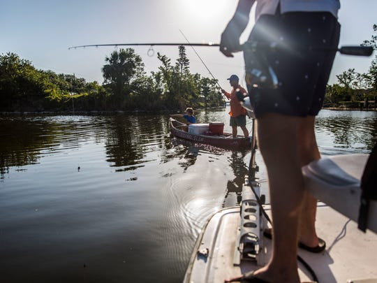 The Wallace family decides where they want to start fishing first during Southwest Florida CISMAÕs Non-Native Fish Round-Up on Saturday, April 28, 2018.