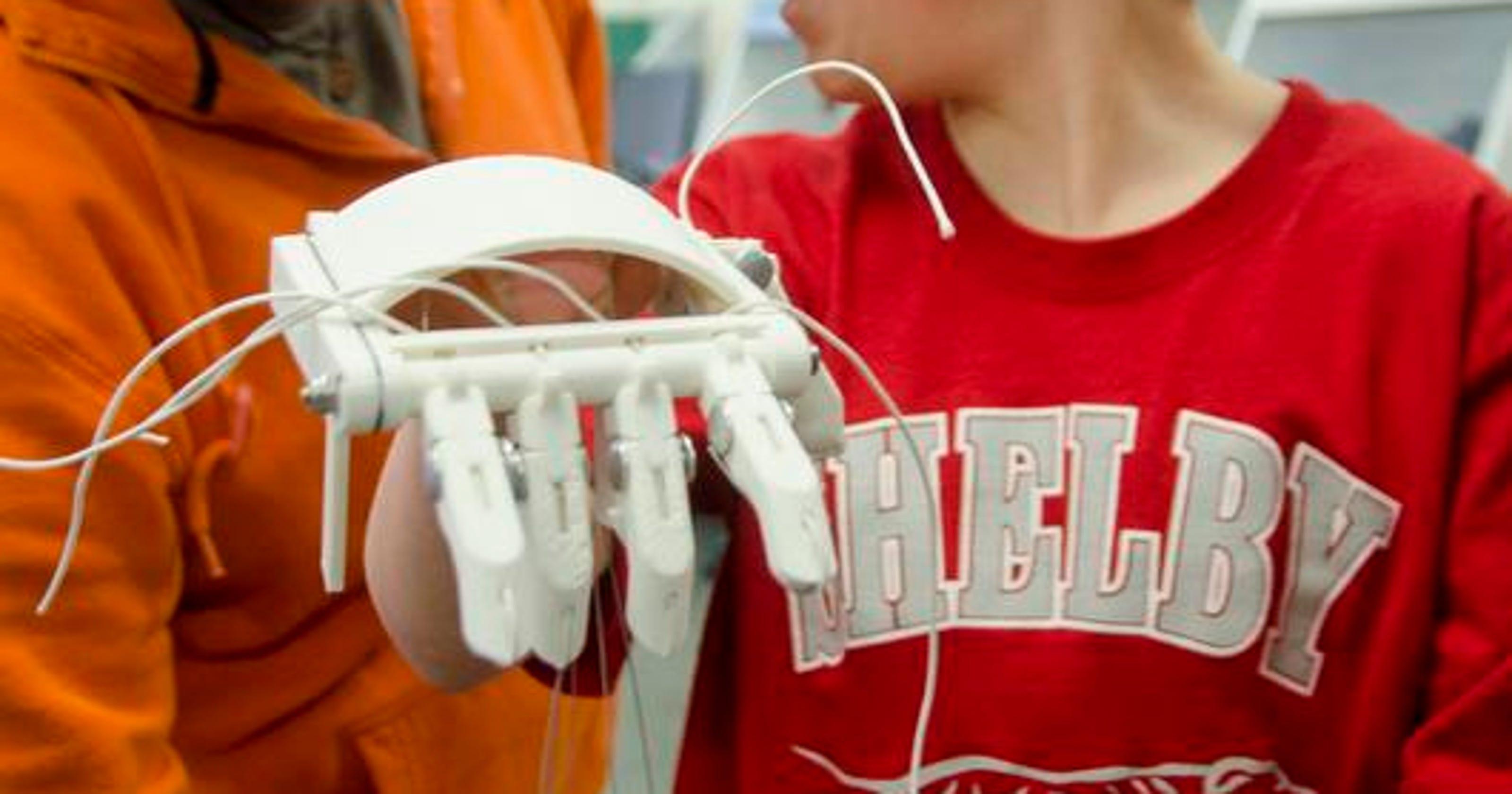 Teens give boy a helping hand