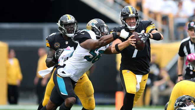 Jacksonville Jaguars defensive end Dante Fowler (56) sacks Pittsburgh Steelers quarterback Ben Roethlisberger (7) during the third quarter at Heinz Field.