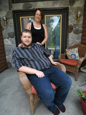 Tyler Wagner and his mom, Robin Baumgartner, seen here at their home in Mattawan, Michigan, can't sue the pharmaceutical company that produced Risperdal for behavioral issues without disclosing side effects.