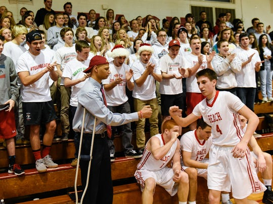 Jeff Bryant, serving as an assistant coach this season while he battles bone cancer, greets the Point Pleasant Beach players prior to the season opener against Mater Dei last Friday.