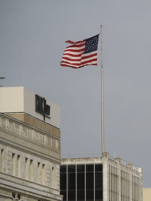 Strong winds caused power outages throughout the region Friday. Downtown Cincinnati was spared, but it was still windy.