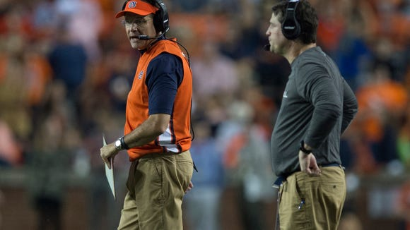 Auburn head coach Gus Malzahn talks to Auburn defensive coordinator Will Muschamp during the NCAA football game between Auburn and Mississippi State on Saturday, Sept. 26, 2015, at Jordan-Hare Stadium in Auburn, Ala. Mississippi State Bulldogs defeated Auburn 17-9.