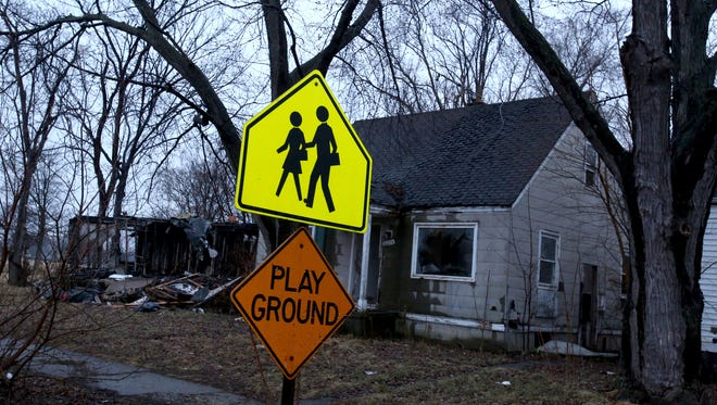 Blight and abandoned homes can be dangerous areas for kids walking to and from school in parts of Detroit.