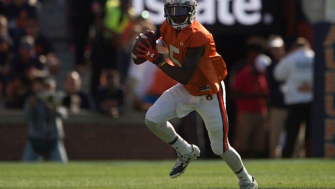 Auburn quarterback John Franklin III (5) runs during Auburn's NCAA spring college football game Saturday, April 9, 2016, in Auburn, Ala.