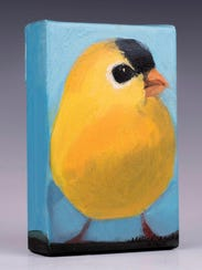 Painting of a gold finch by Molly Cranch, who is featured