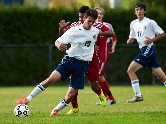 Essex's Danilo Salgado (19) plays the ball during the boys varsity soccer game between the Champlain Valley Union Redhawks and the Essex Hornets at Essex High School on Friday afternoon October 10, 2014 in Essex, Vermont. (BRIAN JENKINS, for the Free Press)