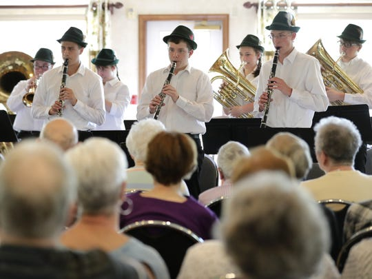 Members of Wespenmusikanten, a Kimberly High School band, perform traditional German and Czech music for residents of Hallmark Place in Kimberly.