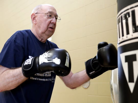 Charles Heidemann of Green Bay participates in a Rock Steady Boxing class, designed to help individuals with Parkinson's Disease maintain strength and motor skills, at Western Racquet & Fitness Club in Ashwaubenon.
