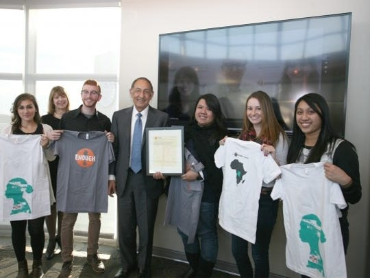 Kean University President Dr. Dawood Farahi (center) and Professor Robin Landa (second from left) with Kean University student designers who worked with The Enough Project to create ads for their #ConflictGold campaign with Rachel Finn, Greg Hittelman and Annie Calloway, members of the Enough team joining via teleconference