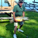 Brett Harper, of Elmira, celebrated Father's Day by hooking this massive brown trout in Seneca Lake.