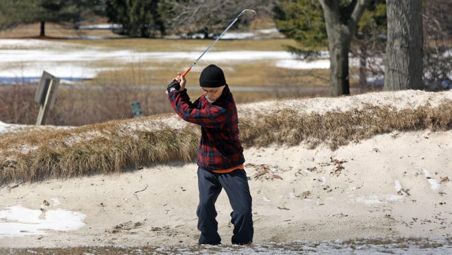 Despite some snow on the ground, golfers make the most of the first day open to the public at Mohansic Golf Course in Yorktown Heights on Wednesday.
