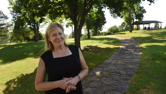 Nancy Tapken, president of the Terrace Park Neighborhood Association, is pleased that  city officials have delayed plans for this year to revamp the park and rip out some of the quartzite pathways.