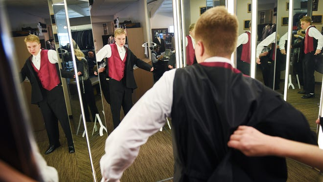 Brandon Valley High School senior Sam Stoltenburg tries on his tuxedo the day before prom, Thursday, April 12, at Men's Wearhouse in Sioux Falls. Brandon Valley administrators decided to move their prom up from Saturday to Friday because of the weather.