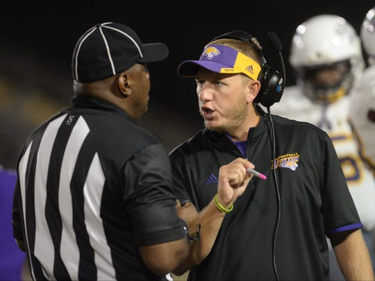 Benton head coach Reynolds Moore talks with the referee