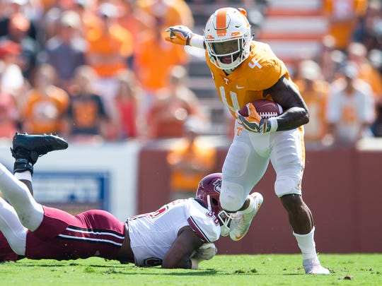 Tennessee running back John Kelly (4) escapes a tackle during Tennessee's game against UMass in Neyland Stadium on Saturday, Sept. 23, 2017.