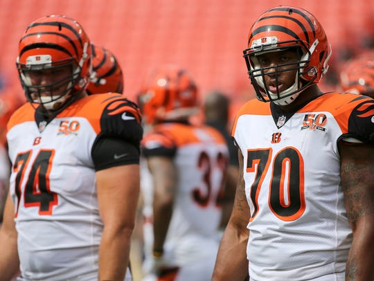 Cincinnati Bengals offensive tackles Jake Fisher, left,