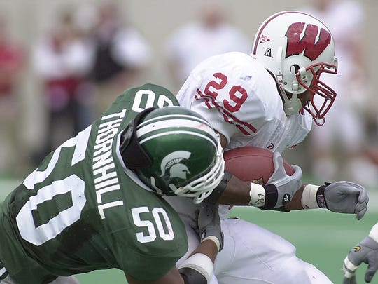MSU's Josh Thornhill (50) brings down Wisconsin's Michael