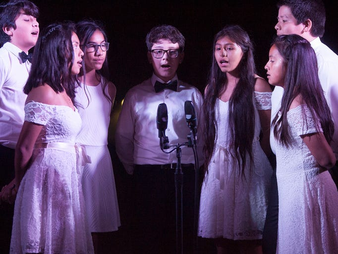 Members of The Infinites sing the Leonard Cohen song