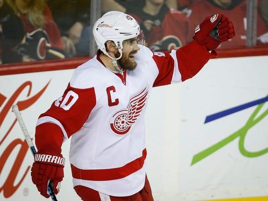 635562719188988792-AP-Red-Wings-Flames-Hockey-J-1-