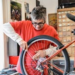 On the corner of Virginia and 10th streets, four new stores opened across from the University of Nevada, Reno. Chad Kortan works on converting a mountain bike in to a road bike at his new bike shop, The Dropout.