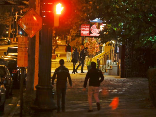People walk along Delaware Avenue in Wilmington's Trolley Square neighborhood, which has not had late night food available for years.