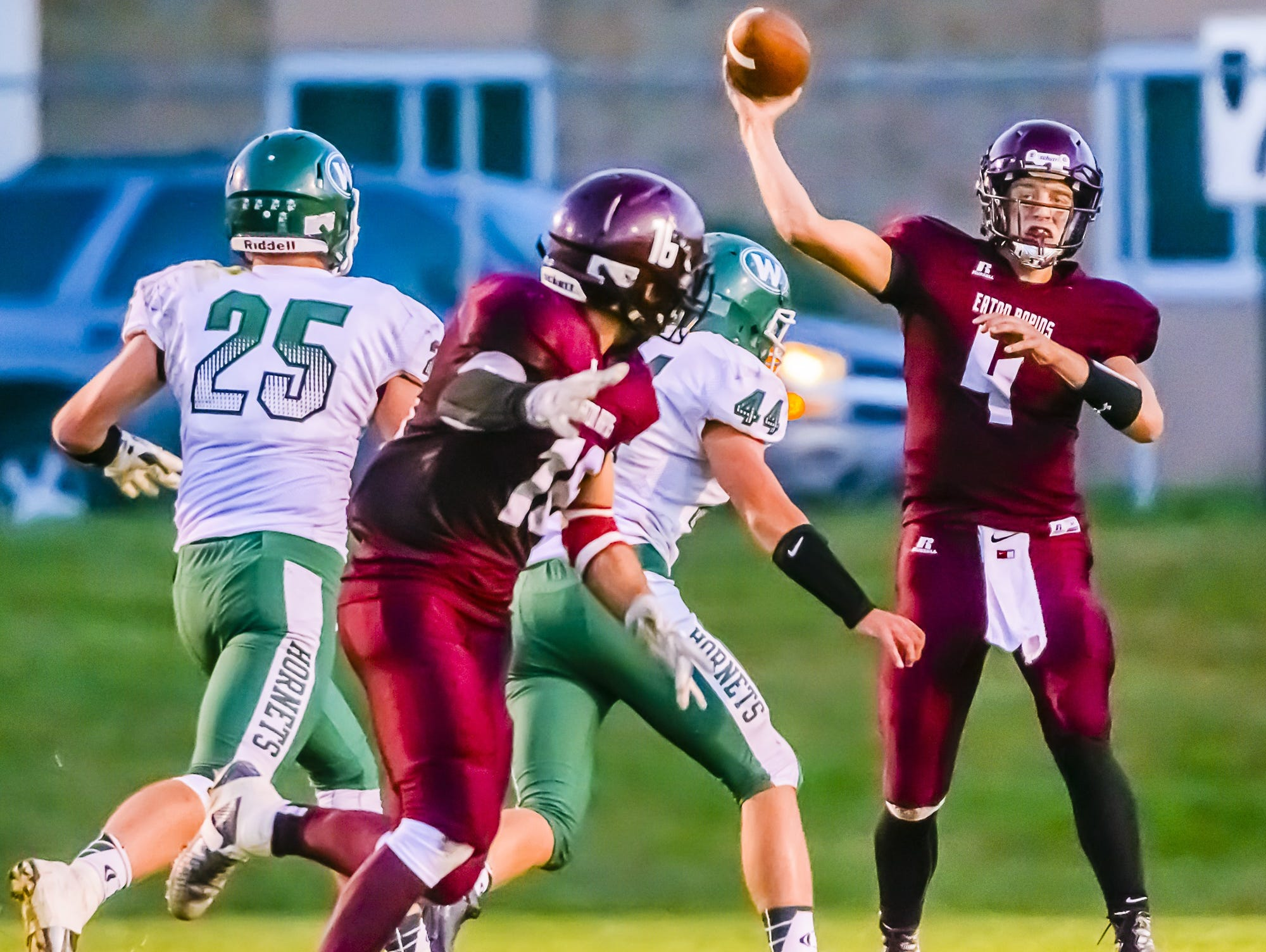 Eaton Rapids quarterbcak Zach Kemp, right, passes to Tristen Schultz, second from left, for a first down during a game against Williamston last year. Kemp and Schultz are both returning for the Greyhounds' offense in 2016.