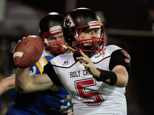 Dylan Couch of Holy Cross looks downfield for the open