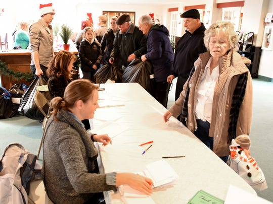 Volunteers help to check in visitors at Civic Concern's party.